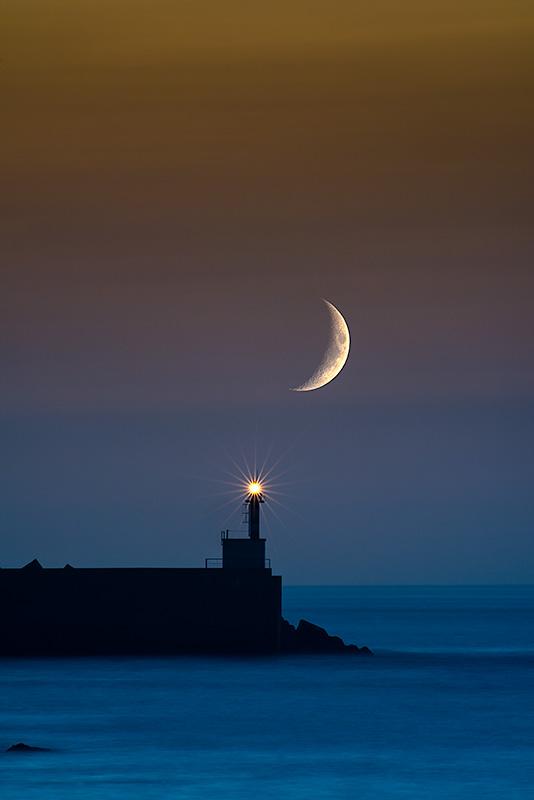 Media luna. Faro de San Esteban de Pravia. Asturias Spain.